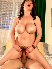 Big-titted mature woman with hairy pussy