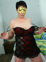 Masked mature slut playing with her body