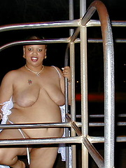 Fat chocolate woman posing outdoor