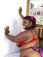 Fat ebony woman  with huge tits