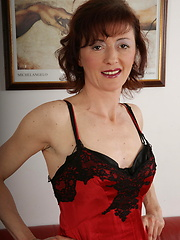 Perverted mature in sexy lingerie and stockings