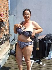Kinky mature slut naked on a roof