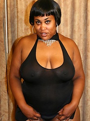 Sassy ebony BBW posing and taking a cock in her pussy by riding on top of a black hunk
