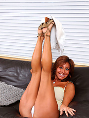 Anilos Tara Holiday spreads her legs wide open and shows off her ass in a thong