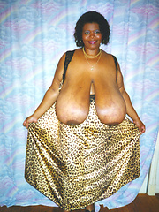 Black mamma shows her really monster tits