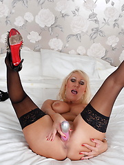 Mature dressed in sexy black corset and stockings