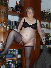 Granny dressed stockings and posing before our camera