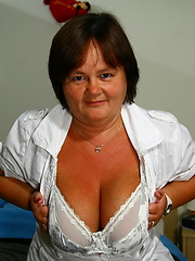 Small and fat mature slaps her big boobs