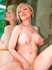 Horny blonde mom enjoying herself in the bath