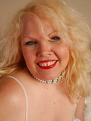 Chubby blonde mature in white stockings