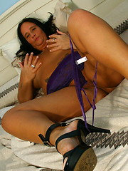 Big titted brunette mature using plastic toy