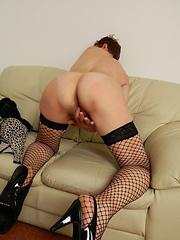 Redhead mature granny spreading her legs