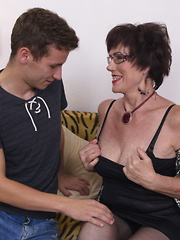 Naughty houswife playing with her toy boy