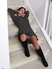 Horny American housewife playing on the staircase