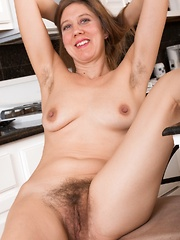 Valentine has fun and strips naked in her kitchen