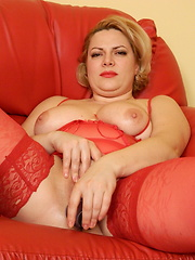 Blonde housewife playing on the couch with her pussy