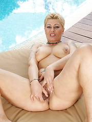 Horny mature slut playing at the pool under the sun