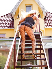 Horny blonde mature slut takes a walk outside