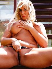 Horny blonde mature slut takes a walk outside