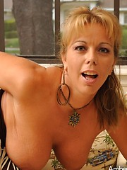 Amber Lynn Bach shows off her big huge sexy tits, round ass and pretty little pussy.