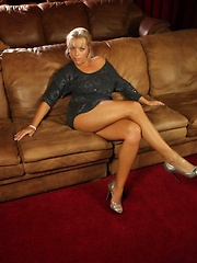 Amber Lynn Bach masturbates in the theatre room.