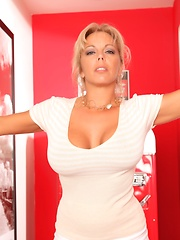 Amber Lynn Bach gets excited as she strips off her sexy white dress, she plays with her wet pussy.