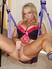 Two slutty whores fist each other in their new sex swing