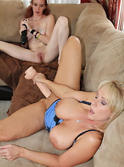 Alysha and new girl Trixie share some toys on the couch