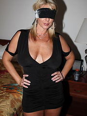 This hot MILF gets blindfolded and gets one cock after another
