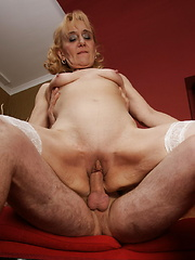 Mature woman riding a hard pole