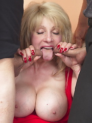 Big breasted mature having an awesome threesome