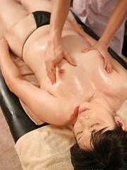 Japanese MILF toyed on the massage table