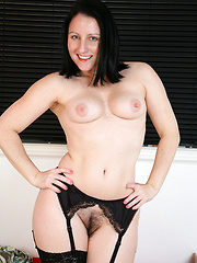 Sensual milf teasing and spreading her juicy pussy
