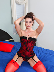 Nora Noir in red stockings spreads her juicy pussy
