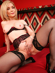 Nina Hartley grinds against her toys during a chat