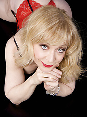Nina Hartley daydreaming horny in red lingerie