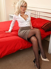 Sexy Syren in black stockings and office dress