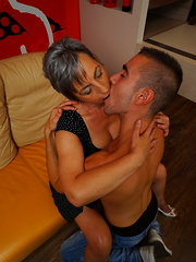 Naughty mature lady playing with her toy boy
