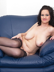Big breasted MILF getting wet on her couch