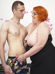 Huge breasted BBW playing with her toy boy