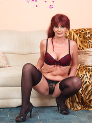 Horny mature woman getting wet on her couch